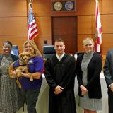(L-R) Treasure Coast Humane Society Director, Jessie Clifford; Family Court Manager, Valerie L. Hoffman; Broward Canine Assisted Therapy Dog Handler, Melinda and Therapy Dog, Emma; 17th Judicial Circuit Juvenile Dependency Judge Jose Izquierdo; Chief Judge Elizabeth A. Metzger; and, 17th Judicial Circuit Chief Judge Jack A. Tuter.